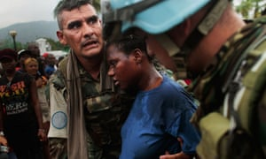 UN peacekeepers look after a pregnant woman after the Haiti earthquake in 2010.