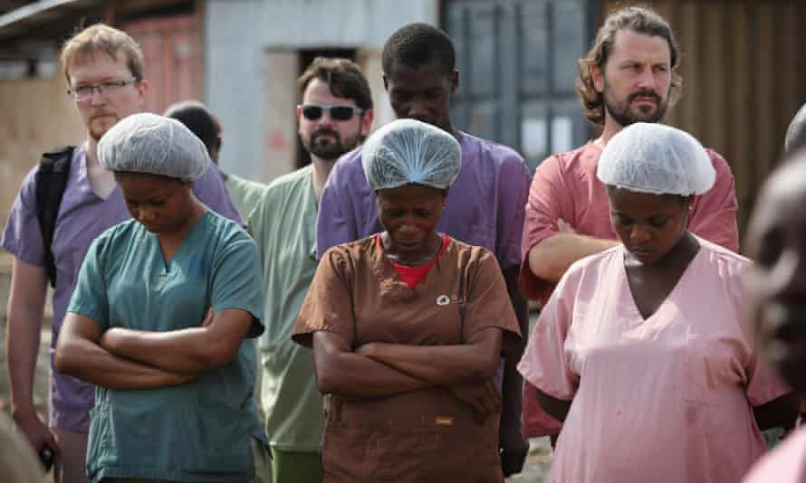 Health workers at an Ebola unit in Paynesville, Liberia.