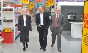 Ian Cheshire walking through a store