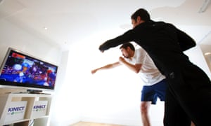 Two men using Xbox Kinect.