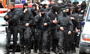 French special forces leave after the assault on the besieged flat of Mohamed Merah in March 2012.