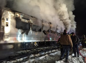 New York, USA A Metro-North Railroad passenger train smolders after hitting a vehicle in Valhalla