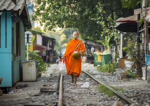 A Buddhist monk on his morning alms rounds in a working class neighborhood. After months of relative calm following the May 2014 coup, tensions are increasing in Bangkok. The military backed junta has threatened to crack down on anyone who opposes the government