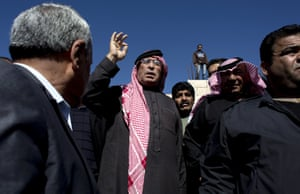 Karak, Jordan Safi al-Kaseasbeh, center, father of slain Jordanian pilot, Lt. Muath al-Kaseasbeh addresses mourners following funeral at the Kaseasbeh tribe's gathering divan at their home village of Ai. Outrage and condemnation poured across the Middle East on Wednesday as horrified people learned of the video purportedly showing the Islamic State group burn a Jordanian pilot to death