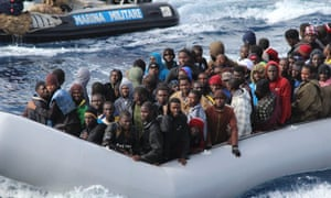 Migrants during a rescue operation by Italian navy off Sicily in in the operation called Mare Nostrum.