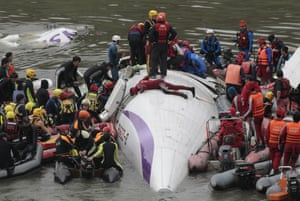 Taipei, Taiwan Emergency personnel try to extract passengers from a commercial plane which clipped a bridge and crashed into a river shortly after takeoff with 58 people aboard