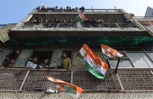 New Delhi, India Congress party supporters watch party vice-president Rahul Gandhi during an election roadshow.  Polling in the Delhi assembly elections will be held on February 7