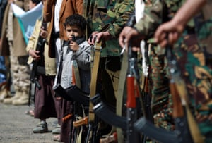 Children hold automatic rifles at a tribal gathering organised by the Shiite Huthi movement supporting the militia which overran the capital in September. The Huthis seized key government buildings last month, plunging the country deeper into crisis and prompting President Abedrabbo Mansour Hadi and his premier to resign