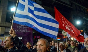 Protesters wave flags at a rally during a pre-election rally in Athens.