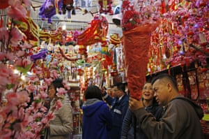 Hong Kong People buy decorations at a store to celebrate the upcoming Chinese Lunar New Year which will mark the Year of the Goat