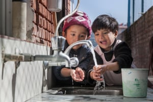 Two children wash hands at Nepal Youth Foundation's nutritional rehabilitation home