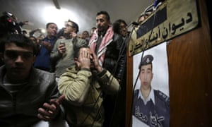 A man prays for the soul of the captured Jordanian pilot, after hearing the news of his execution by Isis.