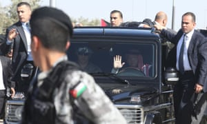 King Abdullah  arrives as Jordanians stand along the way between Amman and Queen Alia airport waiting to greet him.