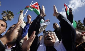 Jordanians chant slogans to show their support for action against Isis.