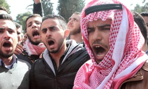 Jordanians shout slogans during a rally to condemn the killing of the Jordanian pilot killed by Isis.