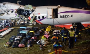 Passengers' belongings are placed in front of the wreckage of the TransAsia ATR 72-600 turboprop plane on the Keelung river bank outside Taiwan's capital Taipei in New Taipei City.
