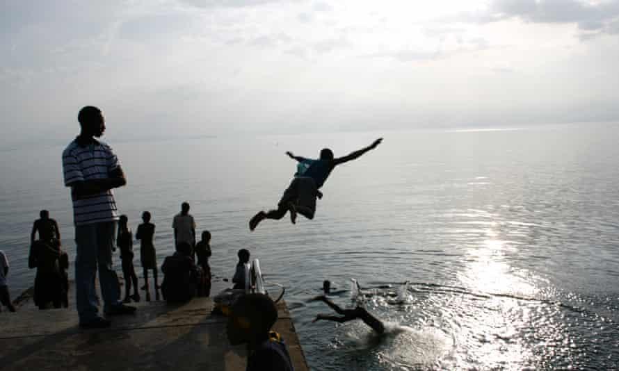 Men dive into the waters of Lake Kivu, Kisegi, Rwanda