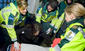 Ambulance staff treating revellers during New Year's Eve in London