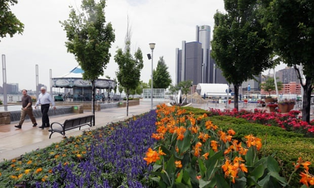 People stroll along the Detroit RiverWalk.