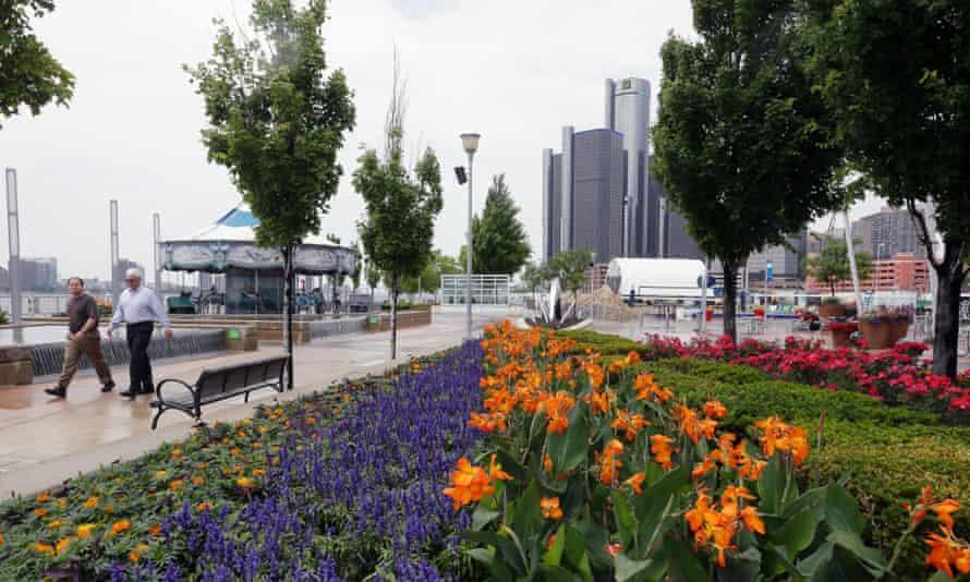 People stroll along the Detroit RiverWalk.