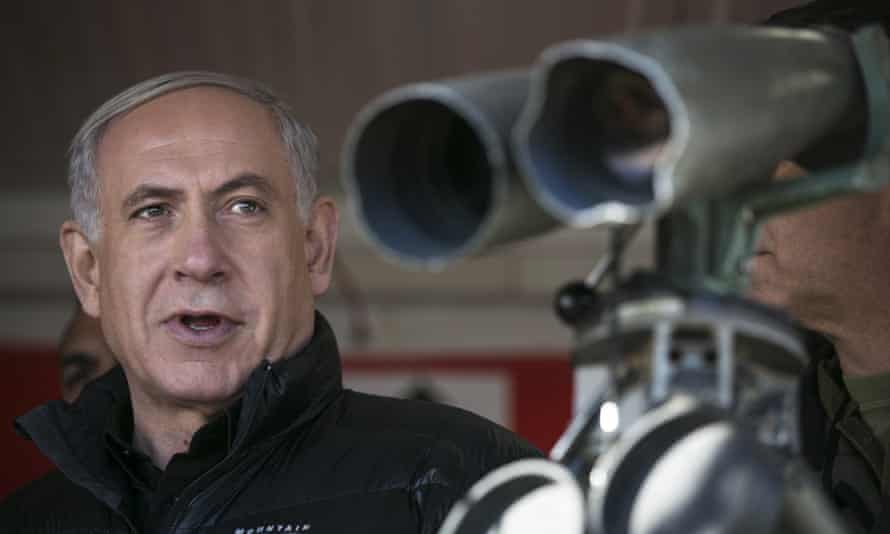 Binyamin Netanyahu visits at a military outpost overlooking the Israel-Syria border on Wednesday