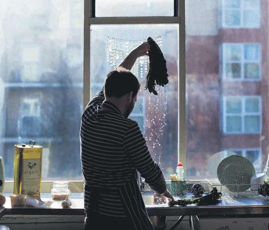Tom Hunt washing cavolo nero in a warehouse.