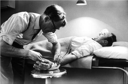 John Sassall treating patients.