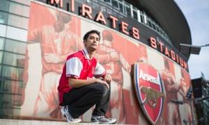 Gay Gooner Dave Raval proudly poses outside Arsenal's Emirates Stadium