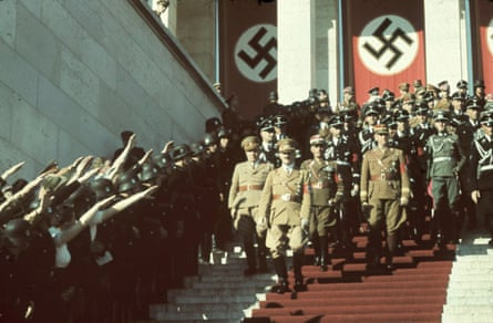 Hitler and his Nazi party officials walk at the 1938 Nuremberg rally.