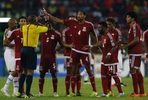 Equatorial Guinea players argue with referee Eric Arnaud Otogo-Castane of Gabon.