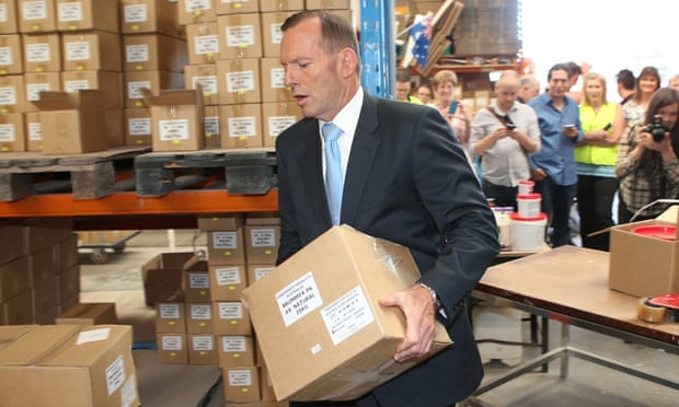 Tony Abbott does some heavy lifting at a timber factory in Melbourne
