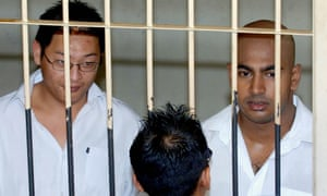 """(FILES) In this file photograph taken on February 14, 2006, two Australian drug traffickers Andrew Chan (L) and Myuran Sukumaran (R) the ringleaders of the """"Bali Nine"""" drug ring, are seen in a holding cell while awaiting court trial in Denpasar, on Bali island. Chan and Sukumaran lost a legal bid to have their cases reviewed on February 4, 2015 dashing their final hope of avoiding the firing squad. AFP PHOTO / JEWEL SAMADJEWEL SAMAD/AFP/Getty Images"""
