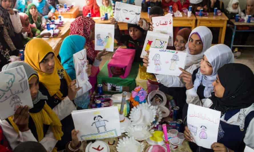 Children holding up anti-FGM pictures they drew at a school in Assiut, Egypt, on 1 February.