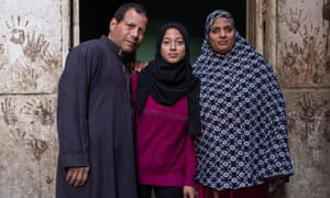 Mansoura Mohamed with her husband Ragab and daughter, Ghada, near their home in Assiut, Egypt. Ghada will not undergo FGM.