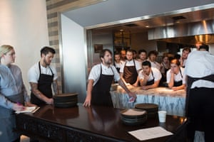 Redzepi speaks to the team during a meeting before lunch.
