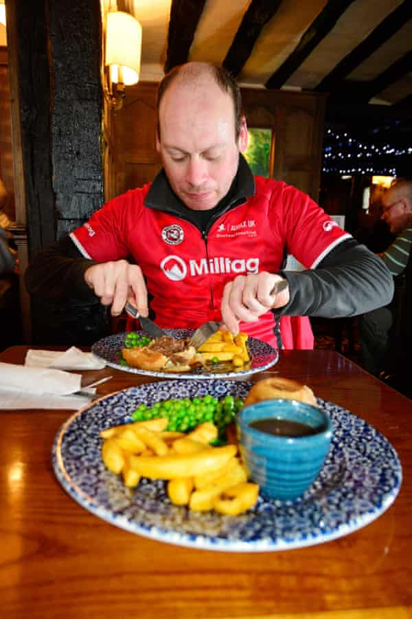 Abraham tucks into a steak and kidney pie, chips and peas at a pub in Tewkesbury,  Gloucestershire.