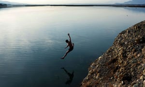 Jalalabad, Afghanistan A youth jumps into a river on the outskirts of the city