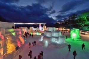 Chitose, Japan People visit the Chitose-Lake Shikotsu Ice Festival illuminated by colourful lights to produce a fantastic world