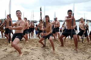 Paihia, New Zealand Members of the Waka (traditional canoe) perform the Haka on the beach at Te Tii Waitangi Marae. The Waitangi Day national holiday celebrates the signing of the treaty of Waitangi 1840 by Maori chiefs and the British Crown, that granted the Maori people the rights of British Citizens and ownership of their lands and other properties