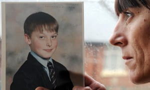 Adam Rickwood's mother, Carol Pounder, holds a photo of him. An inquest jury found unlawful restraint methods contributed to his death.