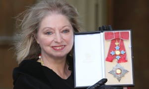Hilary Mantel displays the Dame Commander of the British Empire medal