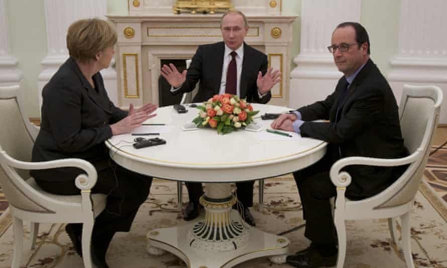 Russian President Vladimir Putin with German Chancellor Angela Merkel and French President Francois Hollande in Moscow urgent meeting.