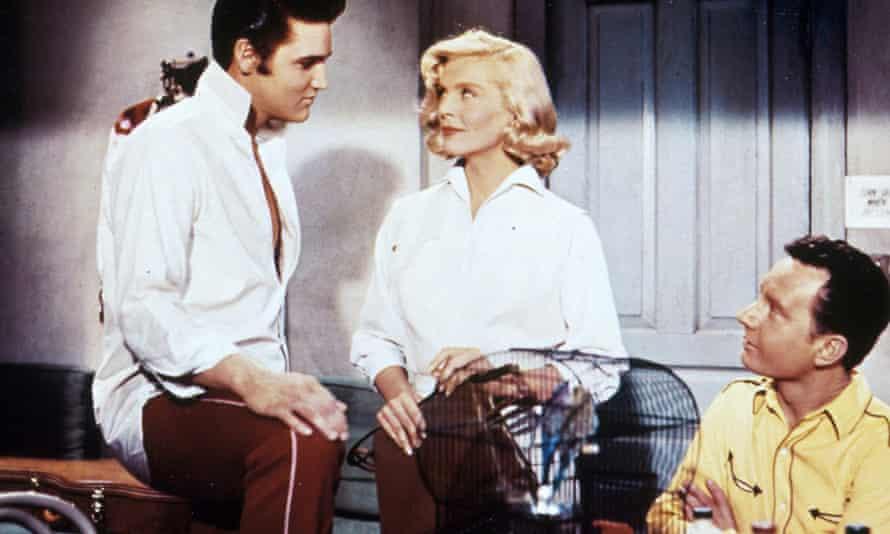 Elvis Presley, Lizabeth Scott and Hal Kanter in Loving You, 1957.