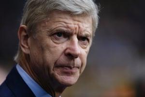 Arsenal boss Arsene Wenger looks concerned