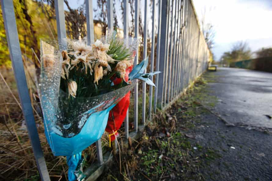 Flowers mark the site of a murder in Cranhill.