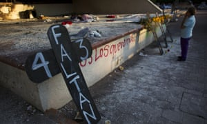 Crosses were set to remember the 43 missing students, in front of the burnt town hall, in Iguala, Mexico.