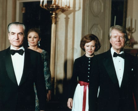 President Jimmy Carter and wife Rosalynn escort Shah Mohammed Reza Pahlavi of Iran and the Shahbanou to a state dinner in the White House