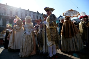 History is plundered and jumbled for costume ideas - although these revellers seem to have mislaid their masks.