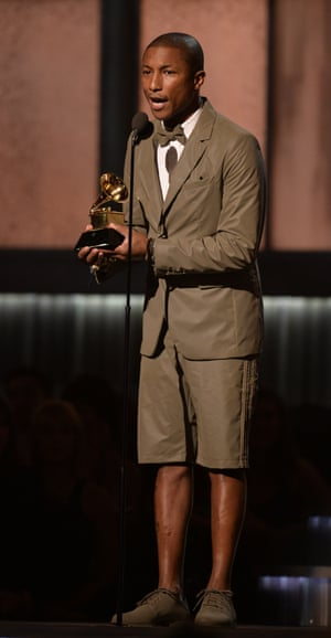 Pharrell Williams accepts his award for best pop solo performance, after his monster hit Happy took global charts by storm. Williams also won best urban contemporary album for Girl.
