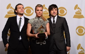 Reid, Kimberly and Neil Perry of the Band Perry pose in the press room after winning best country group performance, with their song Gentle On My Mind.
